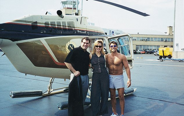 Fraudster, Jordan Belfort (R) with friends before a helicopter f