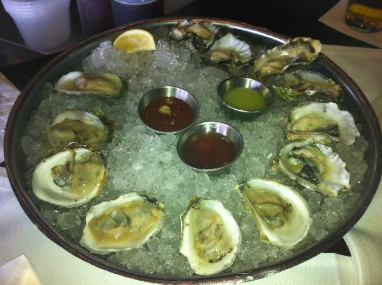 happy hour oyster en four season miami
